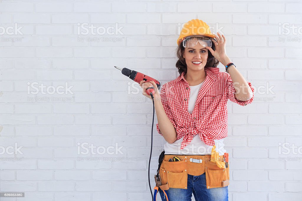 Female manual worker using screwdriver stock photo