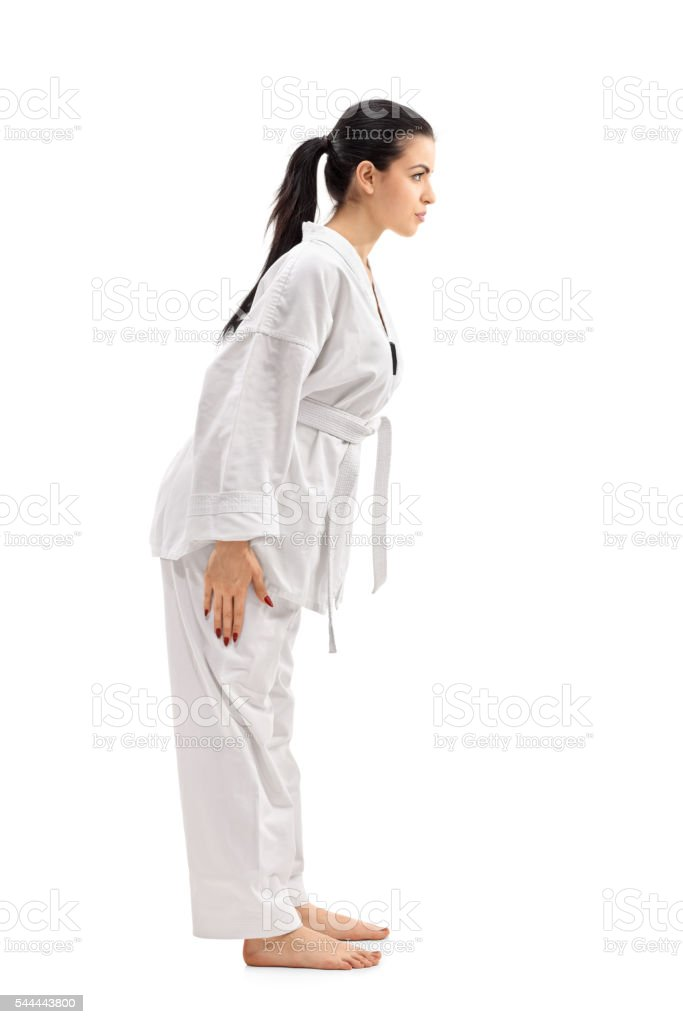 Female martial artist bowing stock photo