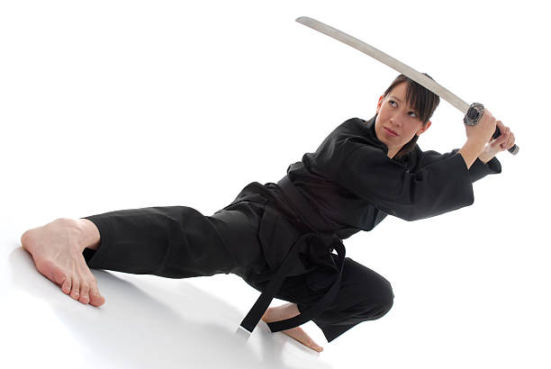 Female martial artist with sword stock photo