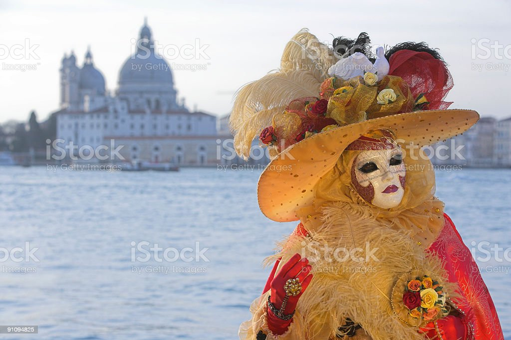 Female mask with Carnival costume and Venice skyline royalty-free stock photo