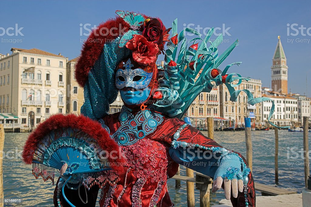 Female mask with colorful costume at carnival in Venice (XXL) stock photo