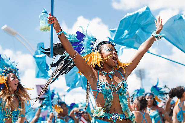 female masquerader in a costume - caribbean culture stock pictures, royalty-free photos & images