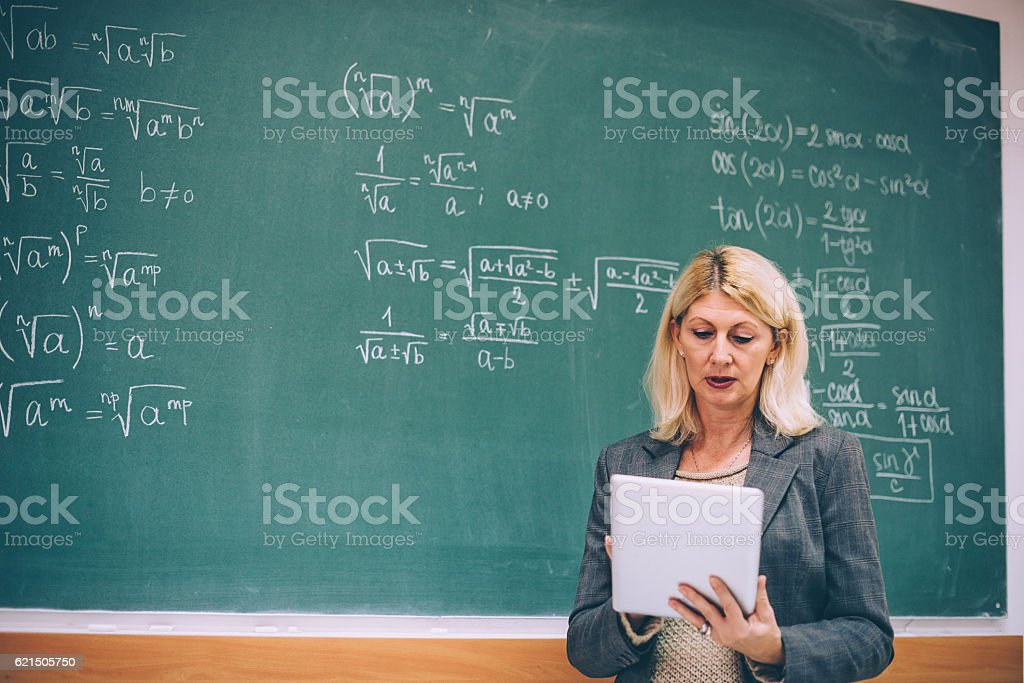 Female math professor in classroom with digital tablet foto stock royalty-free