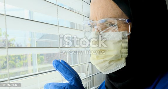 543048812 istock photo female mature muslim health care working posing near a window 1215230611