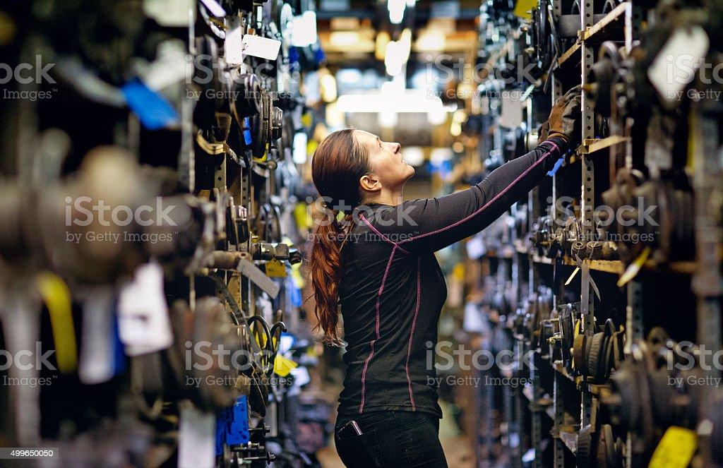 female mechanic organising storage stock photo