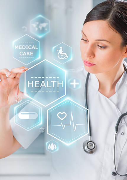 Female medical doctor working with healthcare icons stock photo