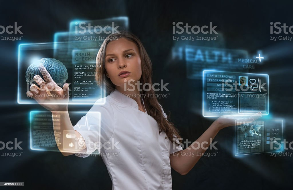 Female medical doctor working with virtual interface. stock photo