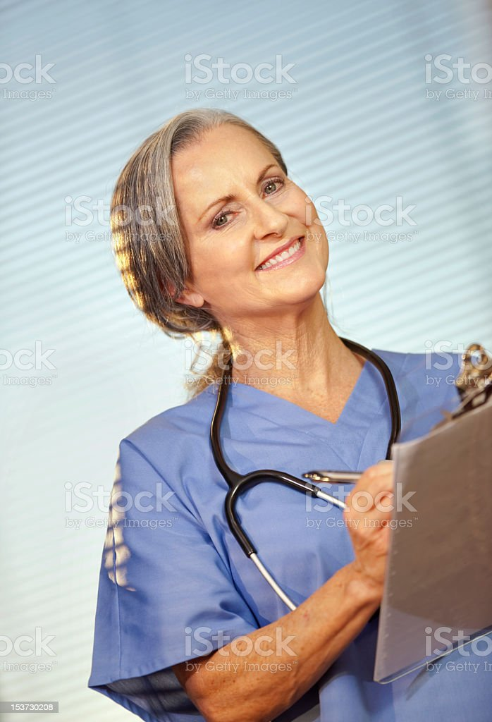 Female Medical Professional Wearing Scrubs stock photo