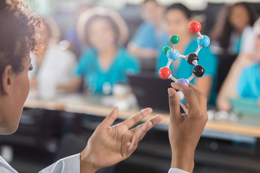 istock Female medical school professor teaches about molecules 638602118