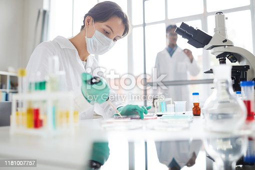 1147277006 istock photo Female Medical Student Working in Laboratory 1181007757