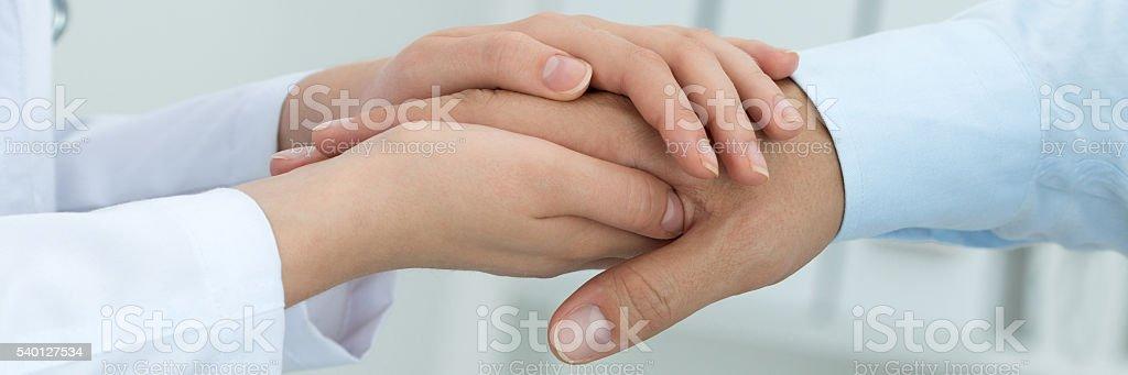 Female medicine doctor reassuring her patient stock photo