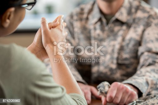 istock Female mental health professional counsels soldier with PTSD 874205560