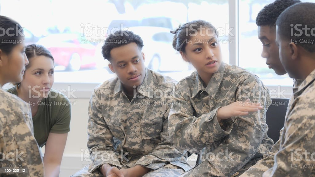 Female Military Cadet Speaks To A Group In Training Class