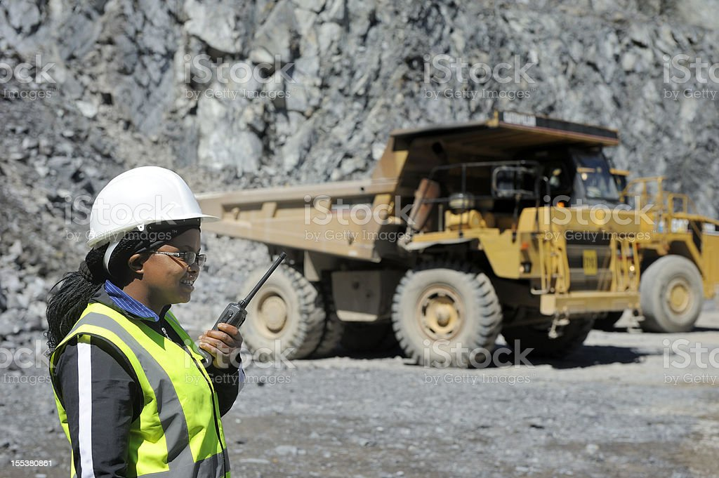 Female mine official oversees work stock photo