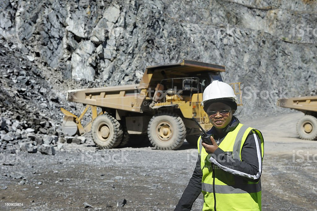 Female mine official supervises work stock photo