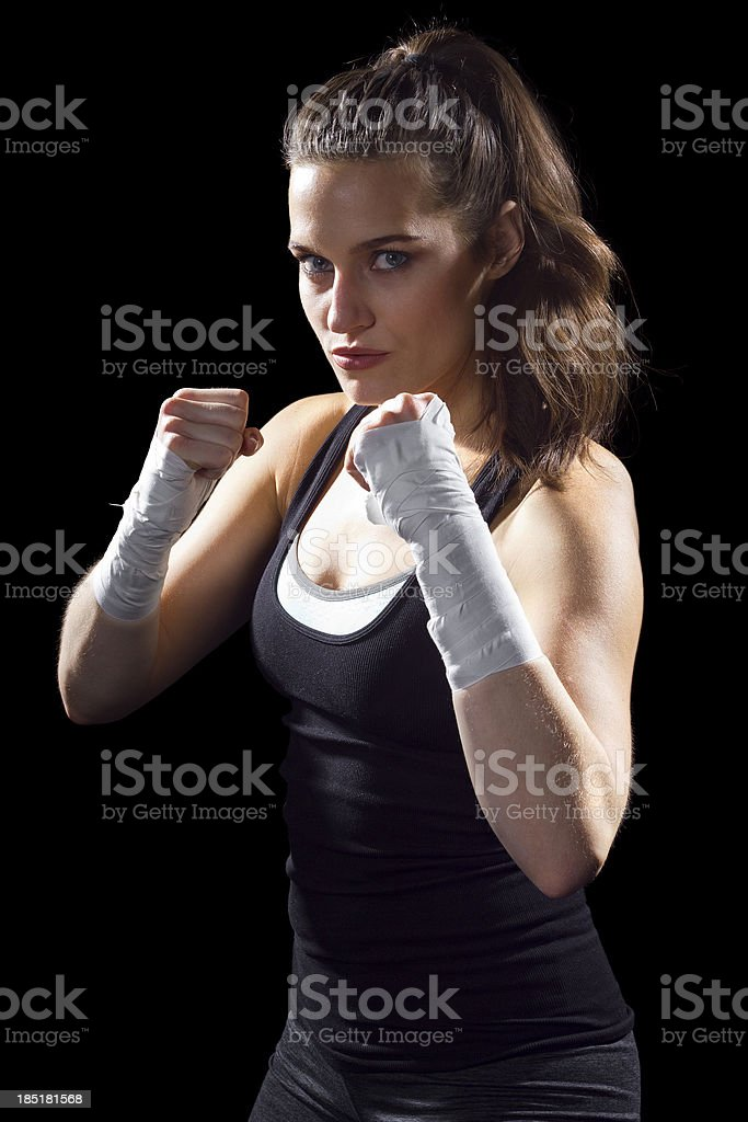 Female MMA fighter in a black background royalty-free stock photo