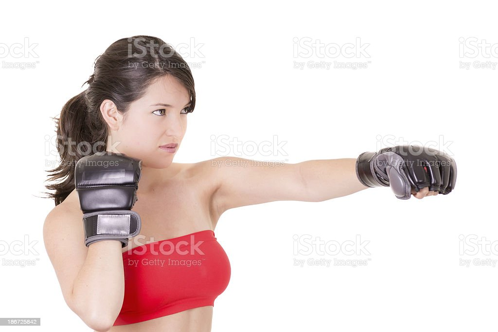 female MMA fighter training white background royalty-free stock photo