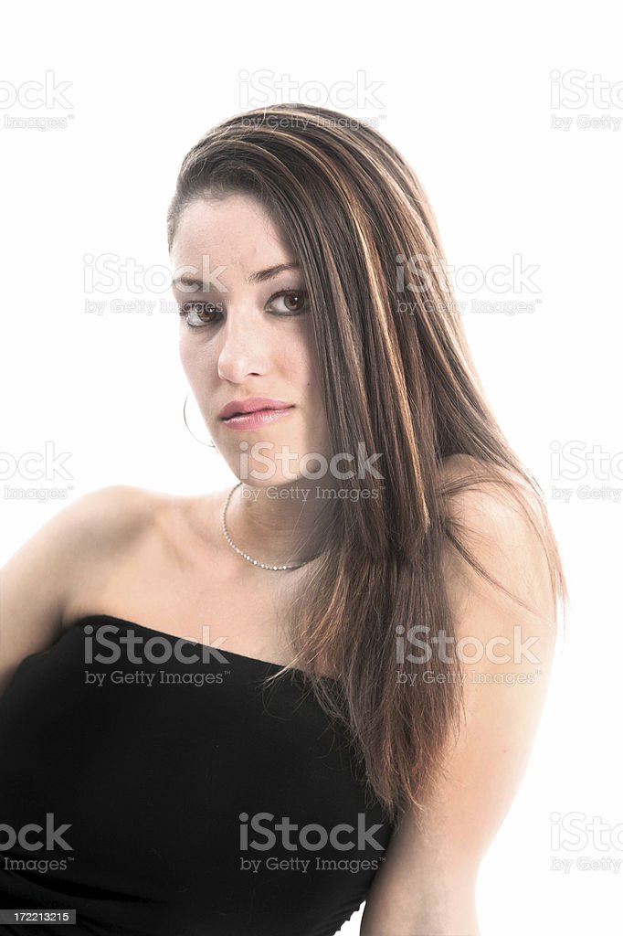 Female model in a black dress posing for camera royalty-free stock photo