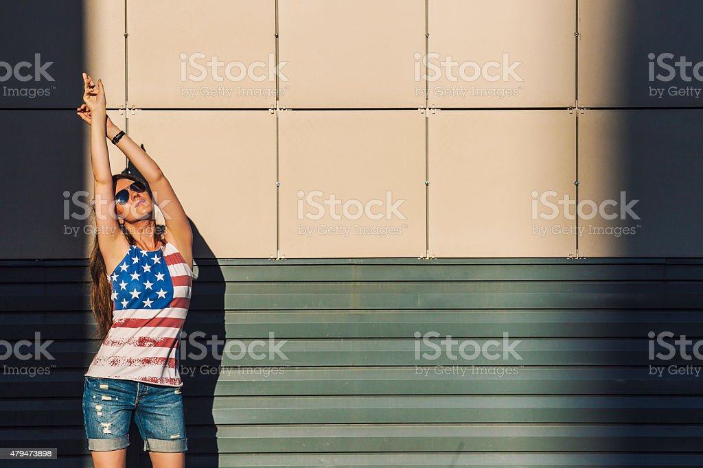 Female model on the background of a building stock photo