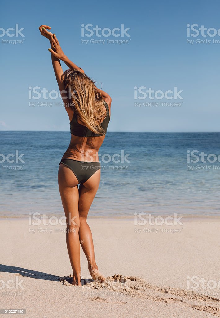Female model relaxing on the sea shore stock photo