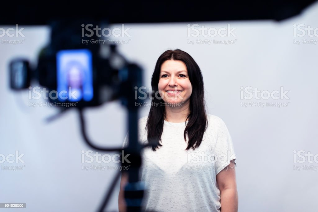 Female model standing in front of the camera at the photo studio royalty-free stock photo