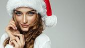 Portrait of beautiful female model wear santa hat
