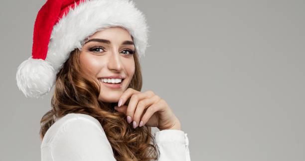 female model wear santa hat - santa hat stock pictures, royalty-free photos & images
