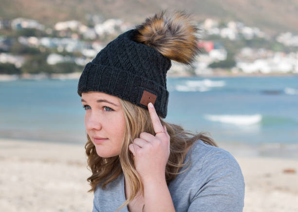 Female model wearing gray knitted beanie stock photo