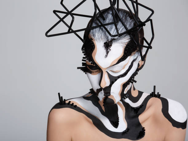 Female model with creative abstract makeup in futuristic hat Female model with creative abstract makeup in futuristic hat. body paint stock pictures, royalty-free photos & images