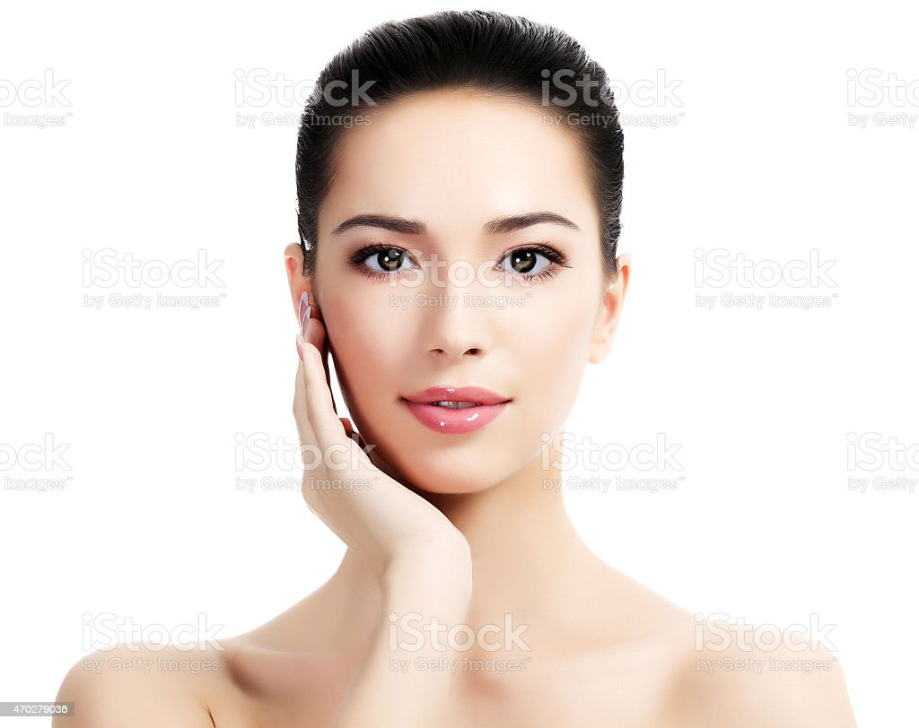 Female model with one hand under her chin stock photo