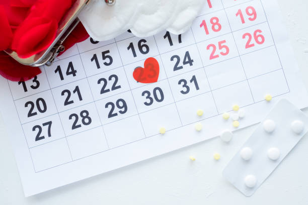 female monthly cycle calendar pills pain treatment - mestruazione foto e immagini stock