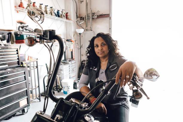female motorcycle mechanic stock photo