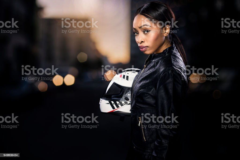 Female Motorcycle Rider or Race Car Driver stock photo