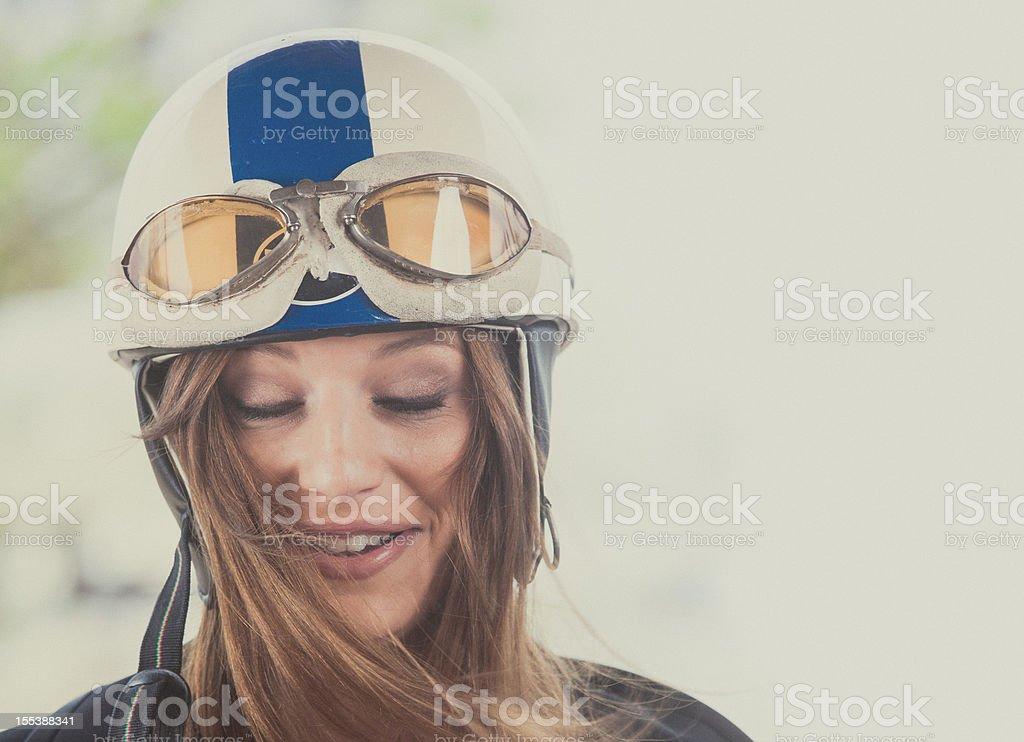 female motorcyclist with vintage helmet stock photo
