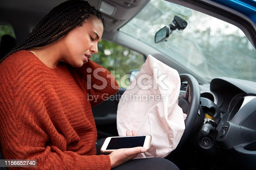 istock Female Motorist Injured In Car Crash After Using Mobile Phone Whilst Driving 1156652740