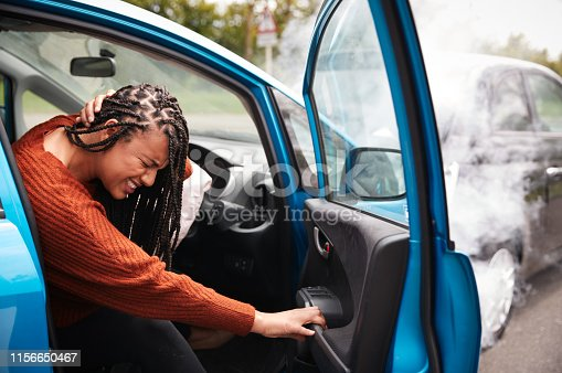 istock Female Motorist With Whiplash Injury In Car Crash Getting Out Of Vehicle 1156650467