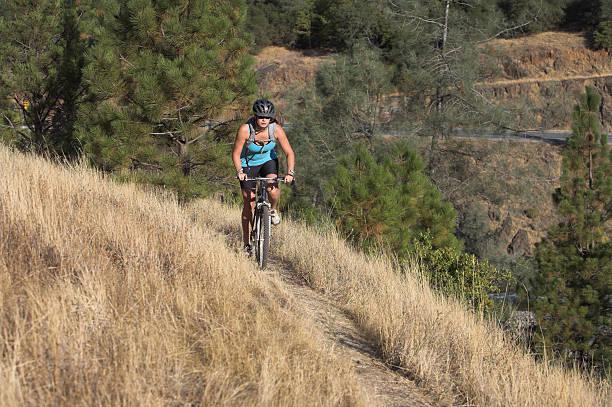 Female Mountain Bike Rider stock photo
