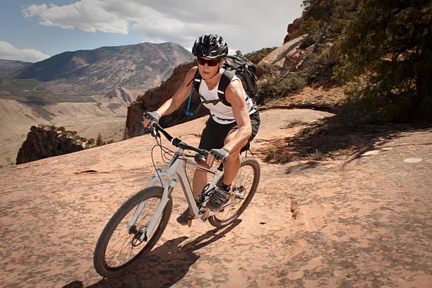 Female mountain biker on Porcupine Rim Trail in Utah. stock photo