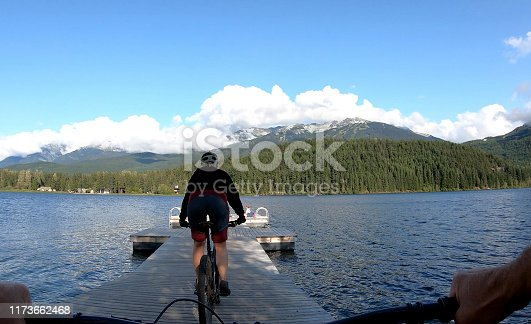 Perspective from behind handlebars of mountain biker