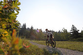 istock Female mountain biker travels along footpath 1036785004