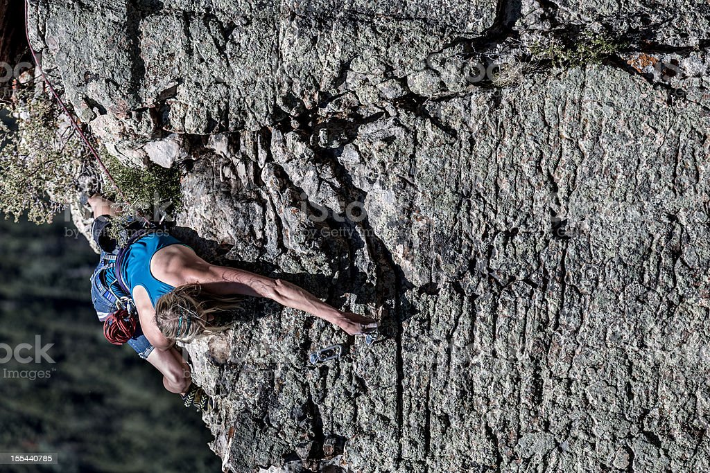 Female Mountain Climber on a Rock Face royalty-free stock photo