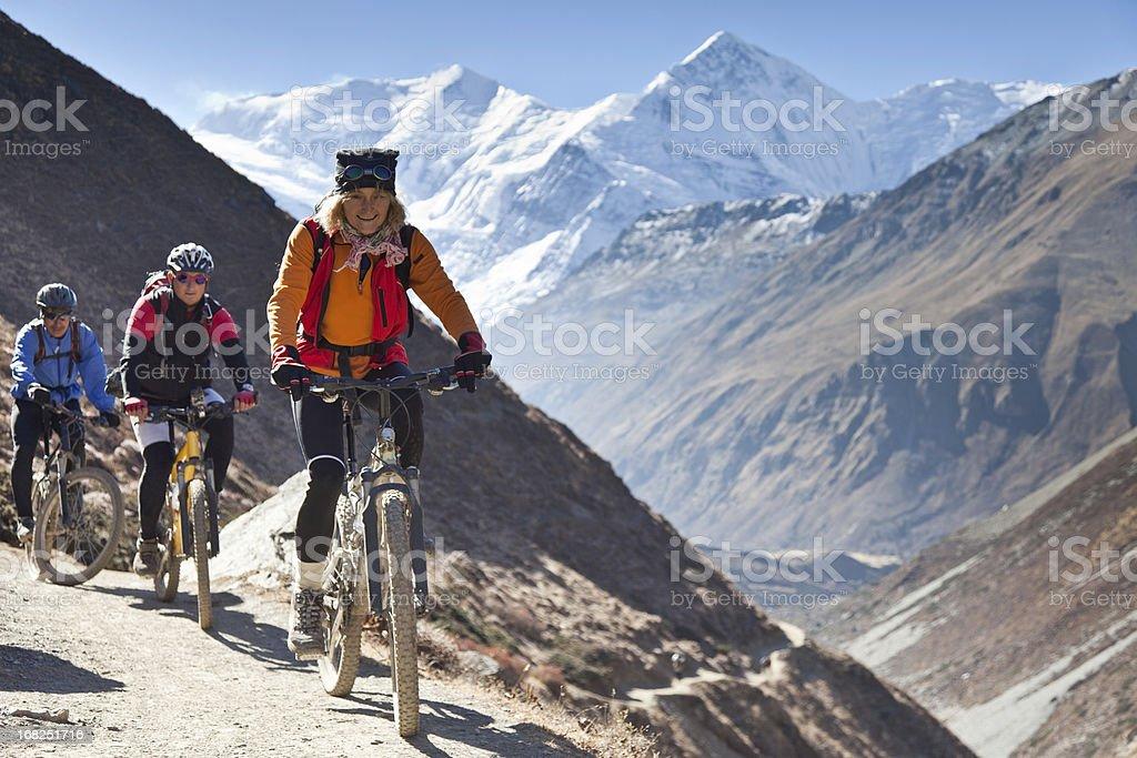 Female mountainbike leader on Annapurna Circuit, Nepal stock photo