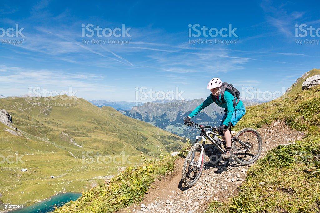 Female mountainbiker at Urdensee turn, Switzerland stock photo