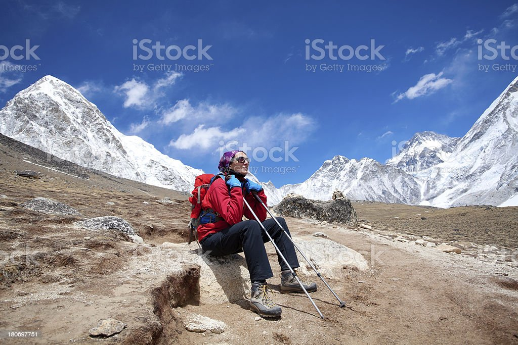 Female mountaineer siting on mountain and enjoy the view royalty-free stock photo