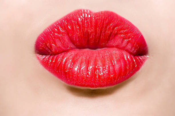 female mouth puckering - human lips stock photos and pictures
