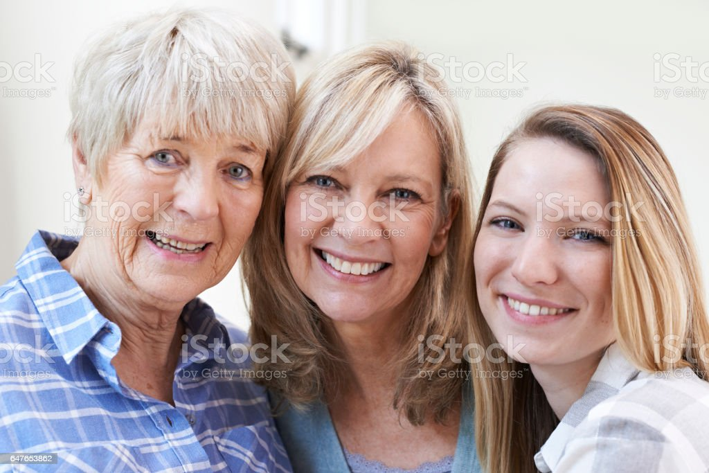 Female Multi Generation Portrait At Home stock photo