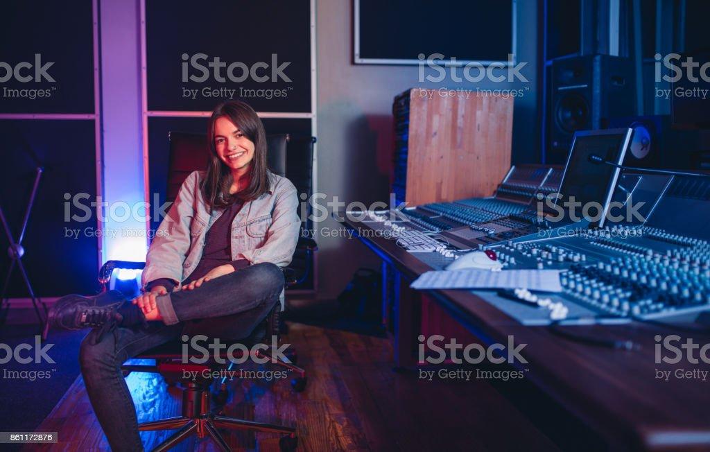 Female music composer at sound recording studio stock photo