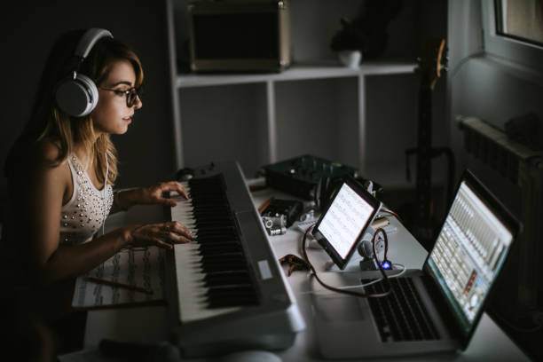 Female Musiciasn Creating Music Pretty Young Woman Playing Music At Home producer stock pictures, royalty-free photos & images