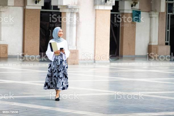Female muslim college student walking on campus full length picture id958479536?b=1&k=6&m=958479536&s=612x612&h=scu5zggmv svoikjnkurt7vrftwkqdbsqvdy0sycpck=