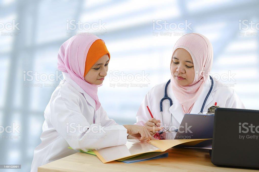 Female Muslim doctor stock photo